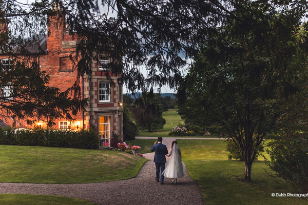 A couple take a stroll at Homme House wedding venue in Herefordshire | CHWV