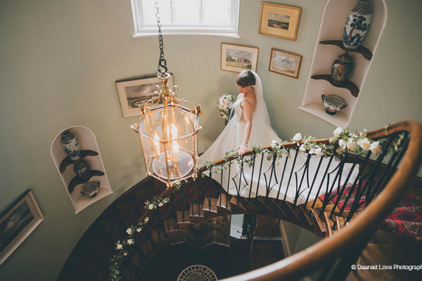 A bride decends the staircase at Homme House wedding venue in Herefordshire | CHWV
