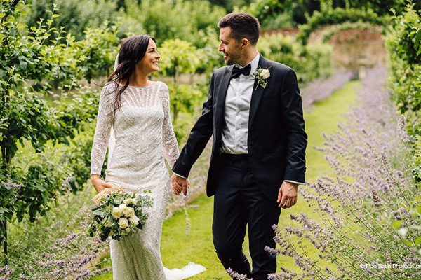Happy couple take a walk at Homme House wedding venue in Herefordshire | CHWV