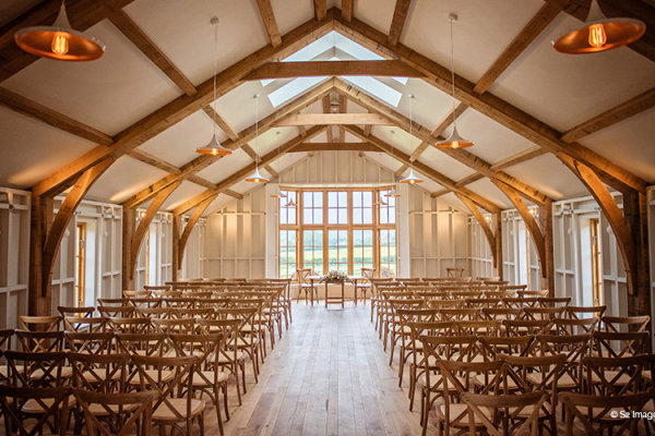 The Grange set up for a ceremony at Hyde House and Barn wedding venue in Gloucestershire | CHWV
