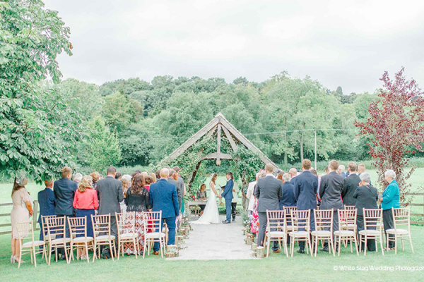 Outdoor wedding ceremony at Hyde House and Barn wedding venue in Gloucestershire | CHWV