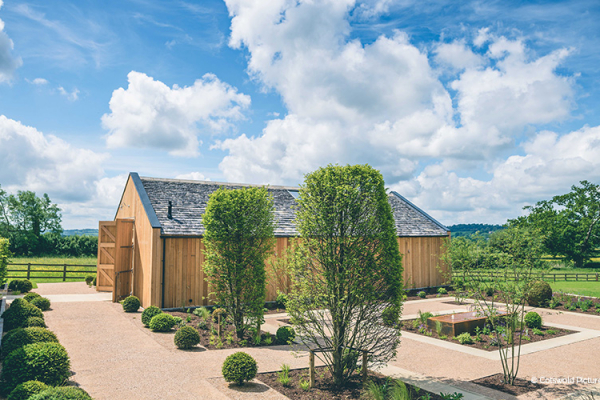 The Grange and courtyard at Hyde House and Barn wedding venue in Gloucestershire | CHWV