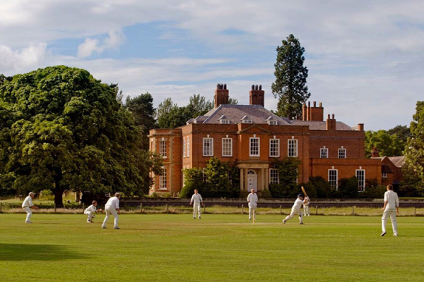 Cricket being played on the grounds at Iscoyd Park wedding venue in Shropshire | CHWV