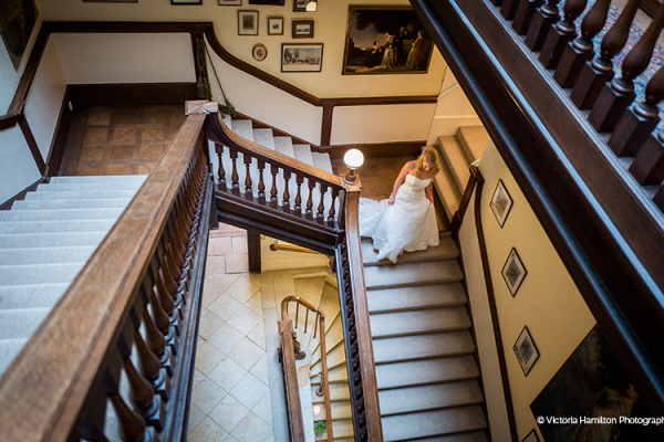 The grand staircase at Kirtlington Park wedding venue in Oxfordshire | CHWV