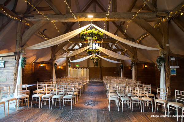 Set up for a ceremony at Lains Barn wedding venue in Oxfordshire | CHWV