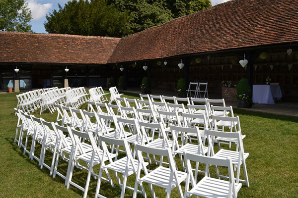Set up for an outdoor ceremony at Lains Barn wedding venue in Oxfordshire | CHWV