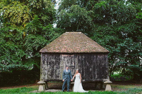 A happy couple in the grounds at Lains Barn wedding venue in Oxfordshire | CHWV
