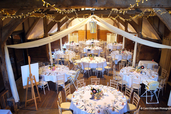 Set up for a wedding breakfast at Lains Barn wedding venue in Oxfordshire | CHWV