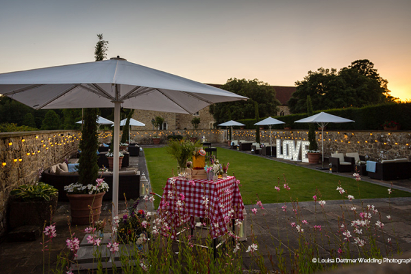 The grounds at Leeds Castle wedding venue in Kent in the evening | CHWV