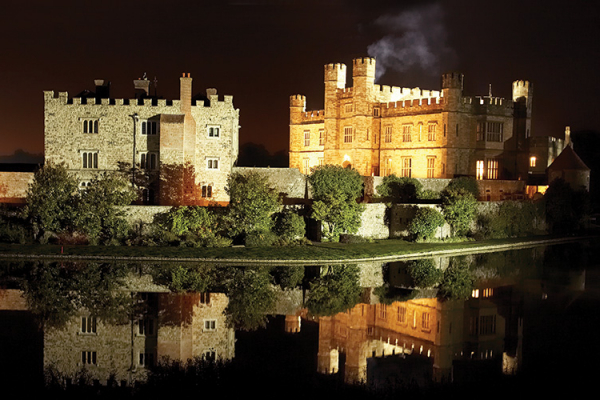 Leeds Castle wedding venue in Kent lit up in the evening | CHWV