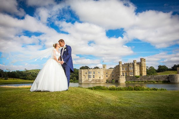 A happy couple in the grounds at Leeds Castle wedding venue in Kent | CHWV