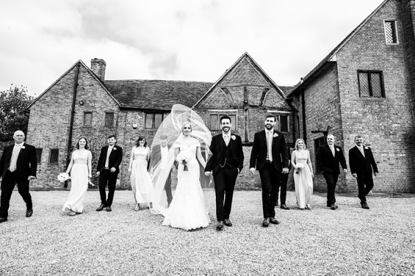 Bridal party in the courtyard at Lillibrooke Manor wedding venue in Berkshire | CHWV