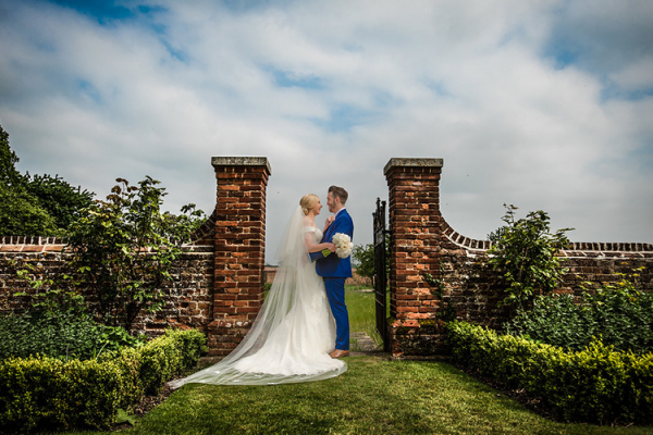 A happy couple in the beautiful grounds at Lillibrooke Manor wedding venue in Berkshire | CHWV