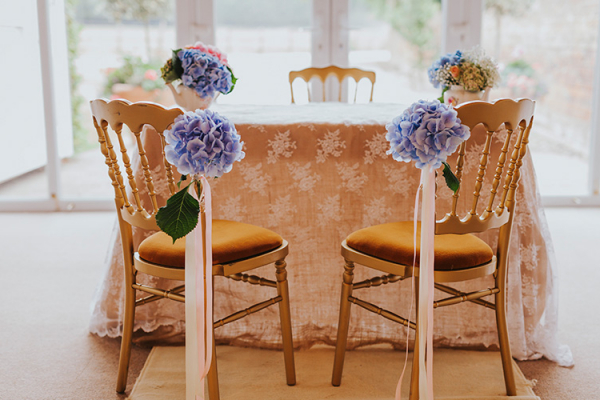 Ceremony table adorned with flowers at Lillibrooke Manor wedding venue in Berkshire | CHWV