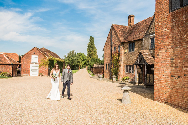 A happy couple taking a moment at Lillibrooke Manor wedding venue in Berkshire | CHWV