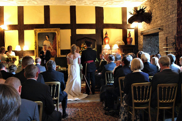 A wedding ceremony in The Great Hall at Llanvihangel Court in Monouthshire | CHWV