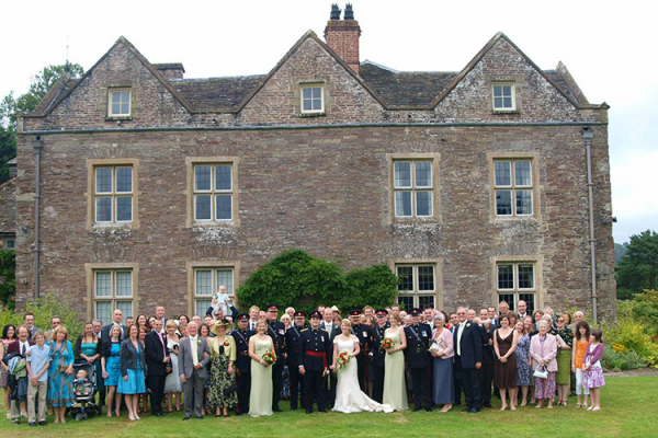 A group shot outside Llanvihangel Court wedding venue in Monouthshire | CHWV