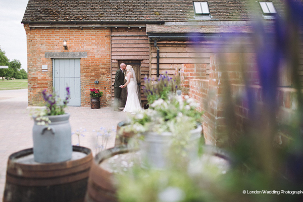 Wedding-couple-enjoying-the-outdoor-spaces-at-Bassmead-Manor-Barns