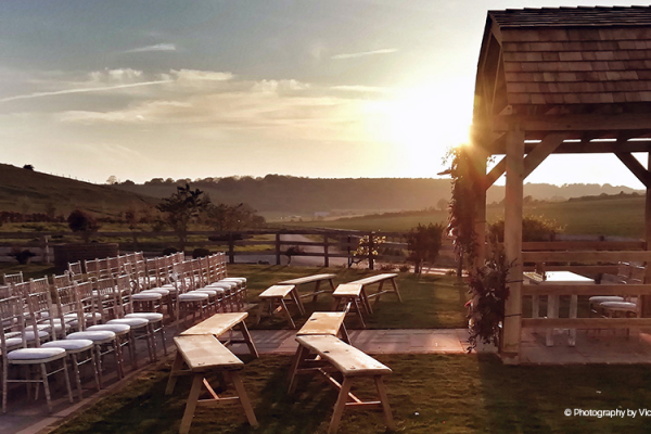 Set up for an outdoor wedding ceremony at Long Furlong Barn wedding venue in West Sussex | CHWV