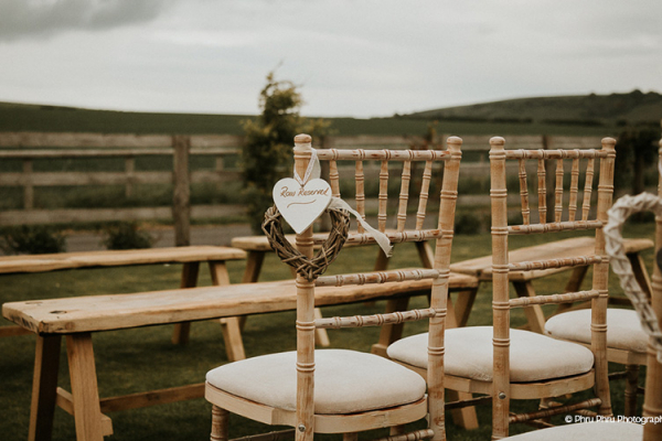 Chair decorations at Long Furlong Barn wedding venue in West Sussex | CHWV