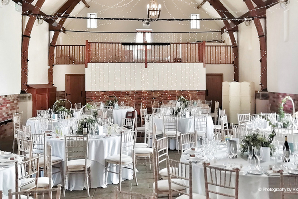 Set up for a wedding breakfast at Long Furlong Barn wedding venue in West Sussex | CHWV