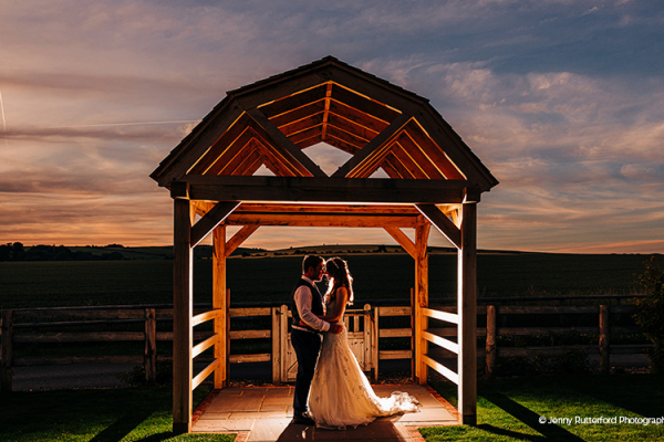 A happy couple taking a moment at Long Furlong Barn wedding venue in West Sussex | CHWV