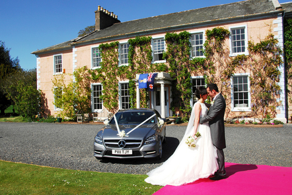 Couple on the Red Carpet at Low House | Wedding Venues Cumbria