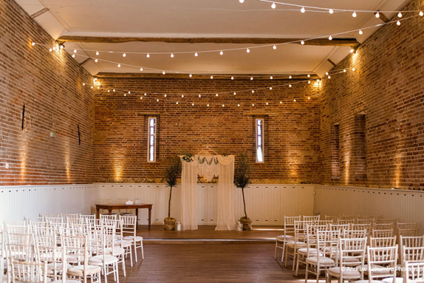 Set up for a wedding ceremony at Manor Mews barn wedding venue in Norfolk | CHWV