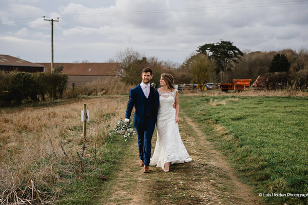 A happy couple taking a moment at Manor Mews barn wedding venue in Norfolk | CHWV