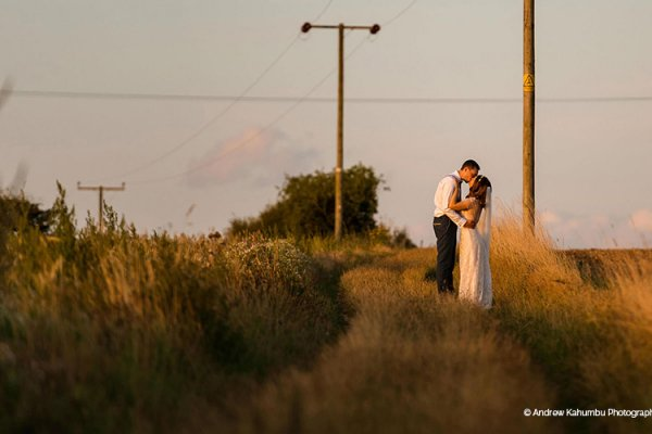 A happy couple taking a moment at sunset at Manor Mews barn wedding venue in Norfolk | CHWV