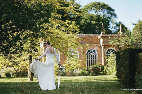 Bride in the beautiful grounds at Mapperton wedding venue in Dorset | CHWV