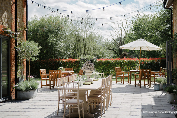 The pretty courtyard at Miillbridge Court wedding venue in Surrey | CHWV