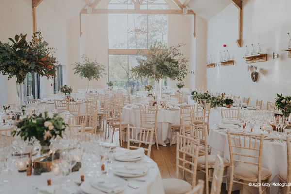 Set up for a wedding breakfast at Miillbridge Court wedding venue in Surrey | CHWV
