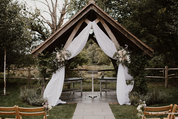 The Arbor outdoor ceremony at Miillbridge Court wedding venue in Surrey | CHWV