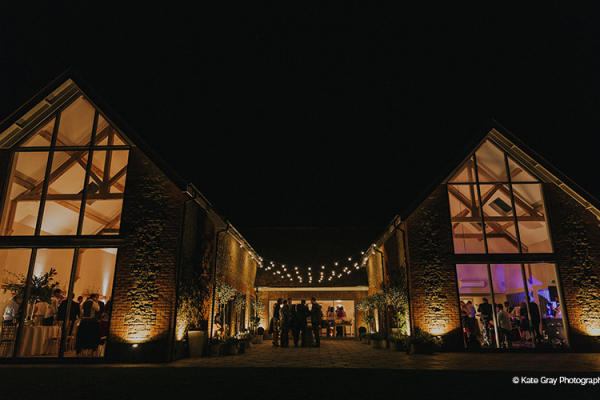 Lit up in the evening at Miillbridge Court wedding venue in Surrey | CHWV