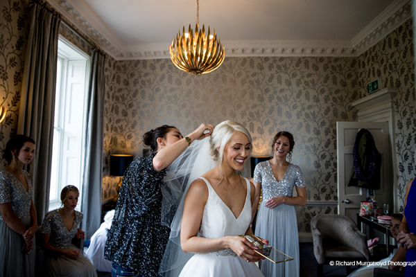 A happy bride getting ready at Morden Hall country house wedding venue in London | CHWV