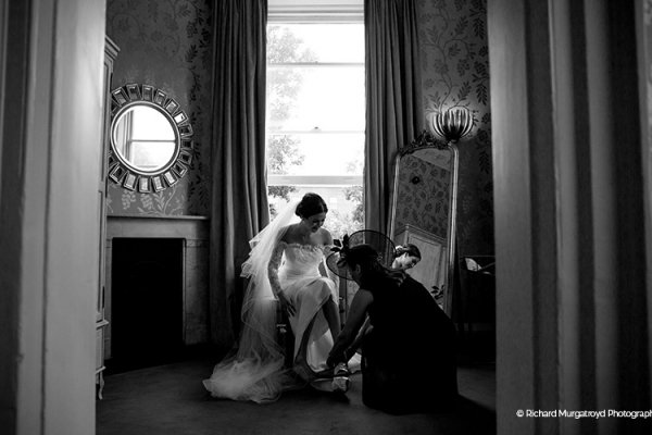 A bride getting ready at Morden Hall country house wedding venue in London | CHWV