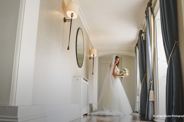 A bride taking a moment at Morden Hall country house wedding venue in London | CHWV