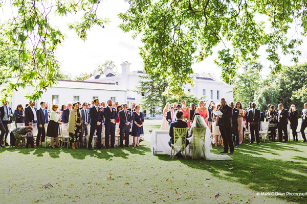 An outdoor wedding ceremony at Morden Hall country house wedding venue in London | CHWV