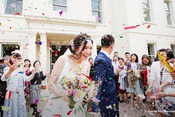 Showered with confetti at Morden Hall country house wedding venue in London | CHWV
