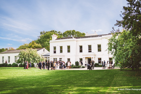 An outdoor drinks reception at Morden Hall country house wedding venue in London | CHWV