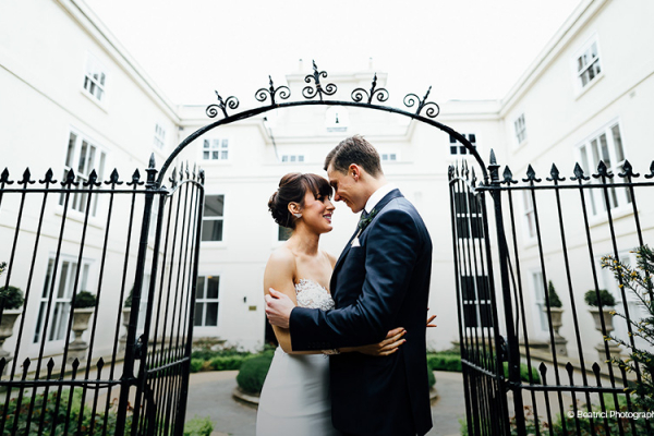 A happy couple taking a moment at Morden Hall country house wedding venue in London | CHWV