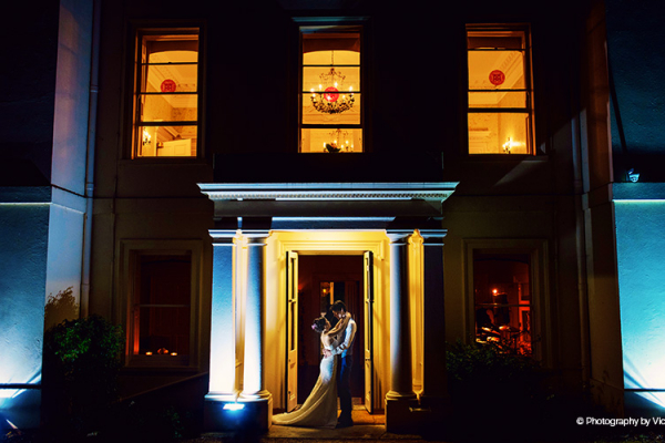 A happy couple taking a moment in the evening at Morden Hall country house wedding venue in London | CHWV