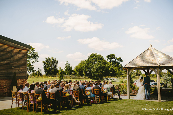 Outdoor wedding ceremony at Mythe Barn