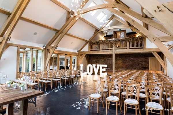 Set up for a wedding ceremony at Mythe Barn wedding venue in Leicestershire | CHWV