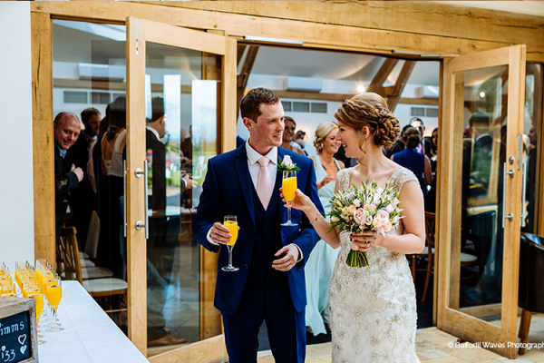 Reception drinks for the bride and groom at Mythe Barn wedding venue in Leicestershire | CHWV