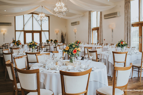 Set up for a wedding breakfast at Mythe Barn wedding venue in Leicestershire | CHWV