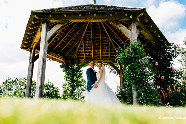 A happy couple taking a stroll at Mythe Barn in Leicestershire