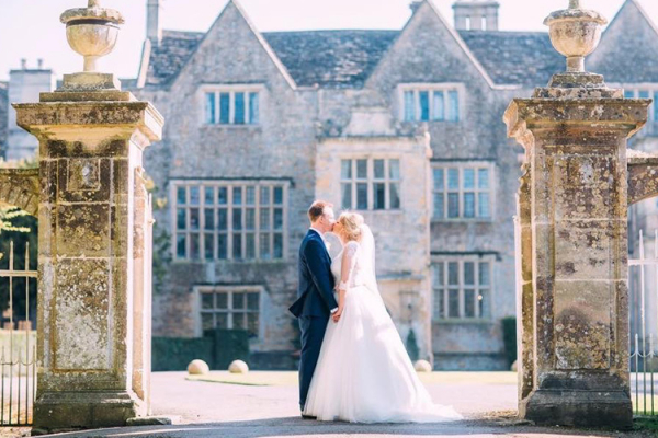 A happy couple in the beautiful grounds at North Cadbury Court wedding venue in Somerset | CHWV