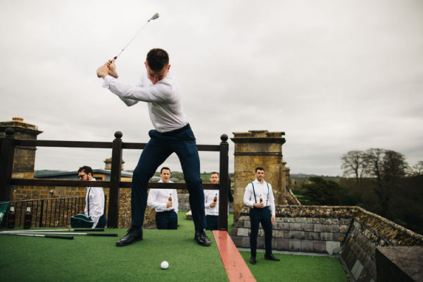 Groomsmen at the golf driving range at North Cadbury Court wedding venue in Somerset | CHWV